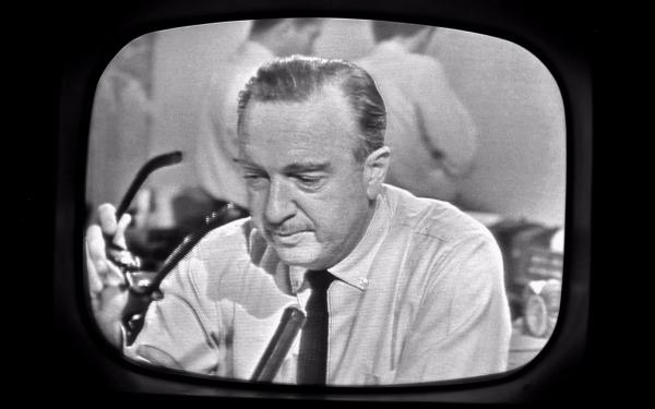 Walter Cronkite removes his glasses while announcing the death of President John F. Kennedy on November 22, 1963.(Getty Images)
