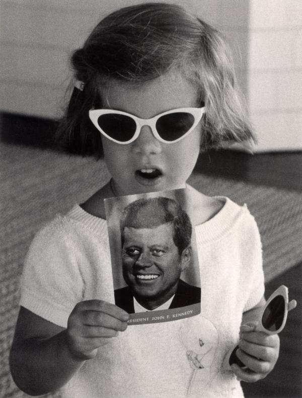 Caroline Kennedy holds up a card with her father's picture on it.