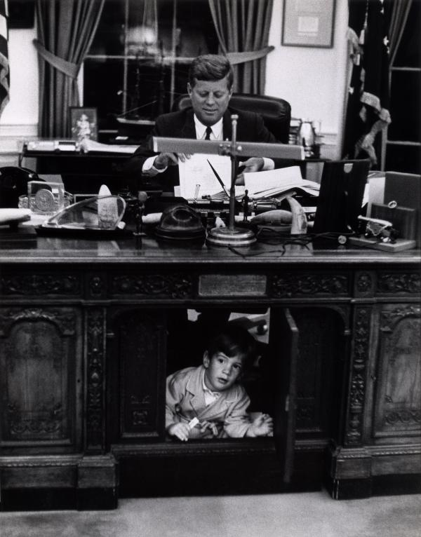 John F. Kennedy Jr. plays as his father works in the Oval Office.