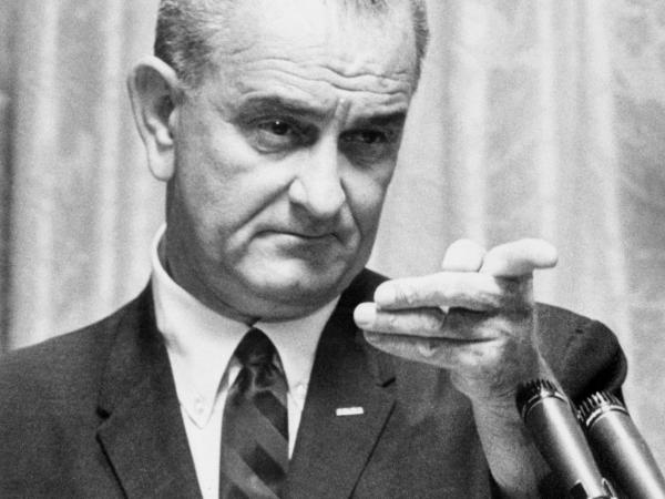 Lyndon B. Johnson delivers a speech 28 July 1965 in the White House in Washington, D.C.
