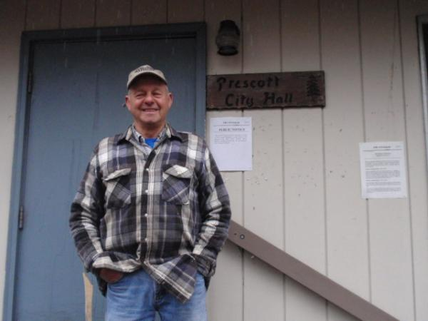 Prescott City Council member Jim Larson stands in front of the City Hall he helped build in 1970.