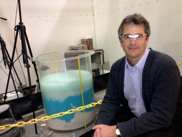 Phil Gauglitz is a chemical engineer with the Pacific Northwest National Laboratory in Richland, Washington. He shows off one of his experiments aimed at solving the problem of possible deep sludge gas at Hanford.
