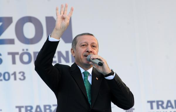 Turkish Prime Minister Recep Tayyip Erdogan gestures the four-finger salute used by supporters of ousted Egyptian President Mohamed Morsi on Saturday.
