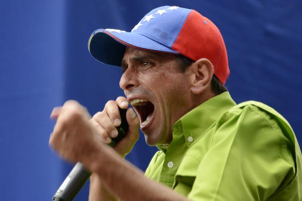Venezuelan opposition leader and Miranda state governor Henrique Capriles speaks during a mass protest in Caracas on Saturday.