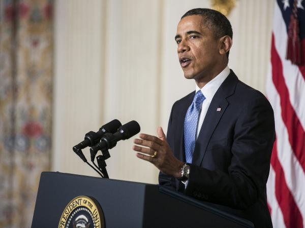 """<!--[if gte mso 9]><xml> <o:OfficeDocumentSettings>  <o:AllowPNG/> </o:OfficeDocumentSettings></xml><![endif]--> During a rare Saturday night address, Obama told the country that while this is """"just a first step, it achieves a great deal."""""""