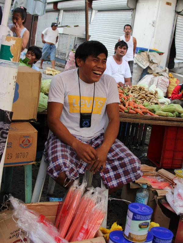 Mark Lakaba, who was a construction worker before the storm, now sells candles, energy drinks and shampoo from a tarp in the market. He says about 90 percent of the goods in the market were looted in the frenzy that followed the typhoon.