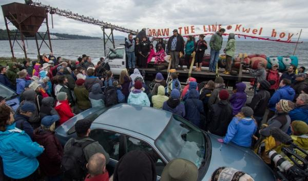 A gathering of coal export opponents last summer at Cherry Point. The event waspart of an anti-coal totem pole journey led by the Lummi Nation. Its tribal members fish at Cherry POint.