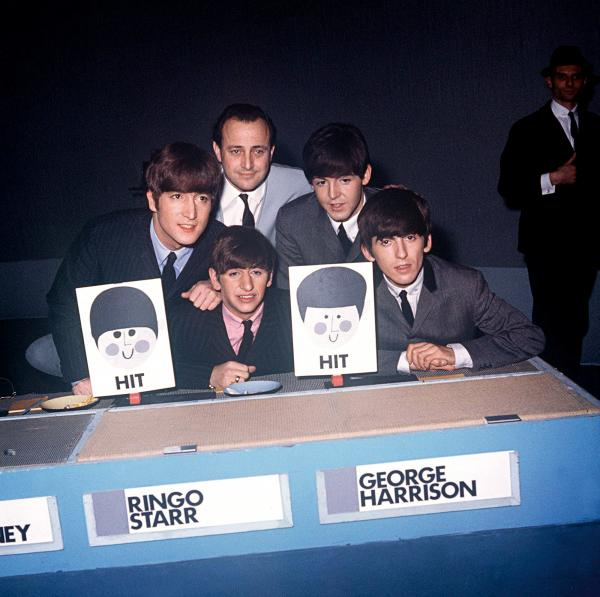 Posing with manager Brian Epstein, The Beatles appear on the BBC1 music panel show <em>Juke Box Jury</em> on Dec. 7, 1963.