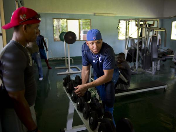 Yulieski Gourriel, a star player for the Industriales team, works out at a gym in Havanaon Sept. 27. He could probably sign a big league contract for tens of millions. In Cuba, top players are lucky to earn $100 a month.