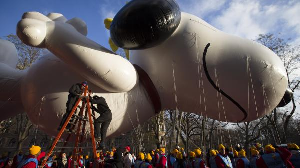 Workers prepare the giant Snoopy balloon before the 87th Annual Macy's Thanksgiving Day Parade on Thursday in New York.