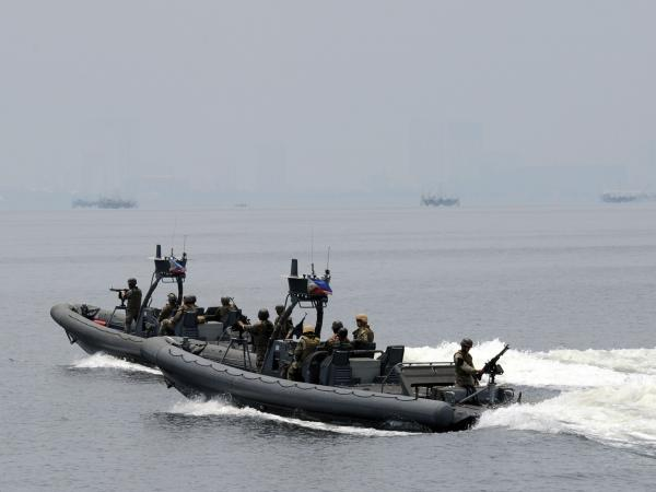 U.S. and Philippine navy personnel patrol the seas off a naval base west of Manila in June as part of joint exercises.