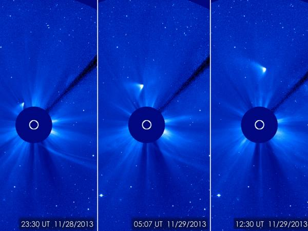 The Comet ISON shows up as a white arrowhead traveling away from the sun. Observers thought ISON had disintegrated when it passed close to the sun, but now it seems some of the comet may have survived.