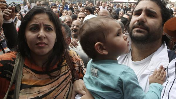Alaa Abdel-Fattah, seen with his wife and child in March, was arrested from his home Thursday.