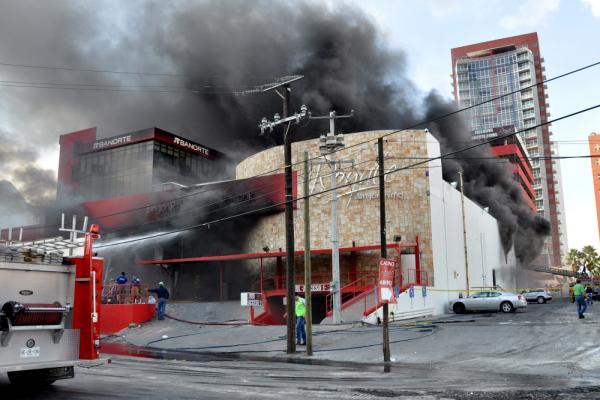 Smoke billows from the Casino Royale in Monterrey, Mexico on Thursday.
