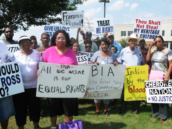 Black Freedmen, who are descended from the slaves of Cherokee Indians, protest  their expulsion on Sept.  2 outside a regional Bureau of Indian Affairs office in Muskogee, Okla. Marilyn Vann, in pink, is the president of the Descendants of Freedmen Association.