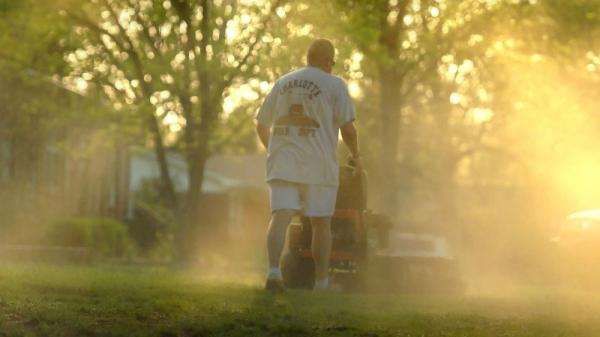 <p>Mowing his lawn, Shane Nantz kicks up a cloud of pollen at his Charlotte, N.C., home, in this file photo from April, 2010. The city is No. 8 on a recent America's Most Congested list.</p>