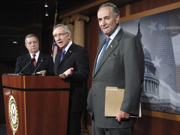 <p>Senate Majority Leader Harry Reid unveils his surtax proposal flanked by Sens. Richard Durbin (l) and Charles Schumer, Oct. 5, 2011. </p>