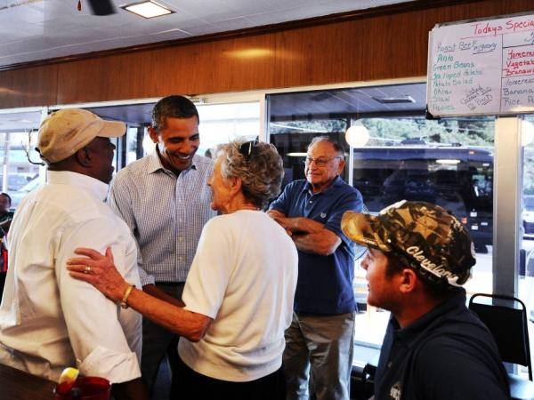 <p>The president greets diners at the Reid's House Restaurant in Reidsville, N.C., on Tuesday. </p>