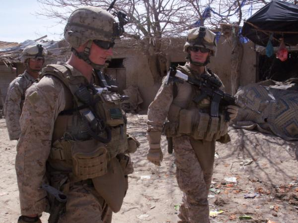 <p>Lt. Col. Jason Morris (right), the commanding officer for 3rd Battalion, 5th Marine Regiment, discusses the Marines' progress during Operation Golden Shillelagh in Malmand, Afghanistan, on March 12, with 1st Lt. Charles Broun.</p>