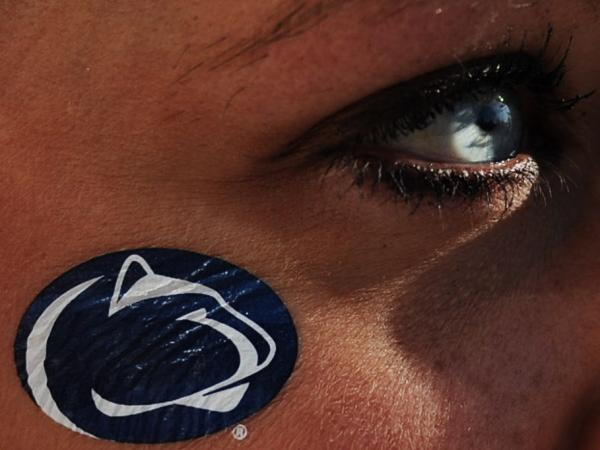 During Saturday's game against Nebraska, a Penn State fan looks on in State College, Pa.
