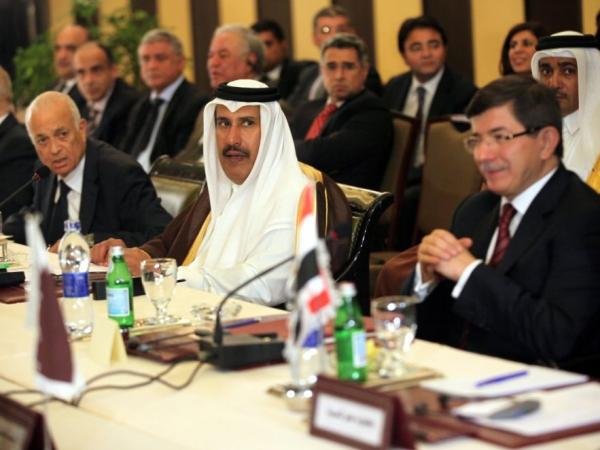 Arab League Secretary General Nabil Al Arabi (far left) meets with foreign ministers of the Arab League in Cairo on Nov. 27. The group imposed tough sanctions against Syria at that meeting, but is now wavering when it comes to implementing them.
