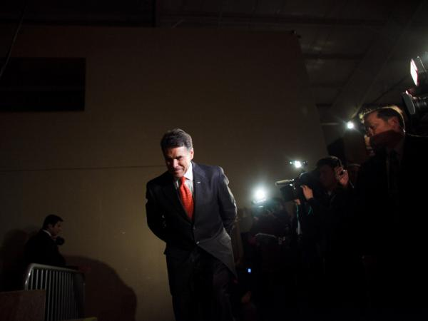 Perry prepares to speak with voters attending the West Des Moines caucus in Iowa on Jan. 3.