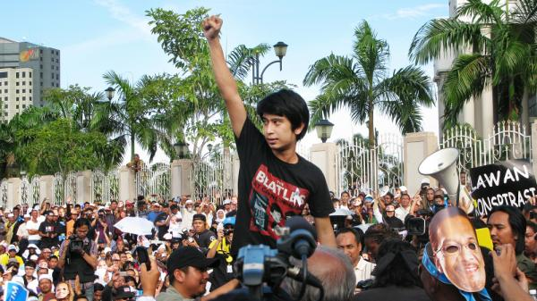 Student activist Adam Adli addresses protesters outside Malaysia's high court in Kuala Lumpur on Jan. 9. The crowd was awaiting a verdict in the trial of opposition leader Anwar Ibrahim, who was acquitted on charges of sodomy shortly afterward. Adam is leading the fight to abolish a decades-old law that bans college students from joining or speaking in support of political parties.