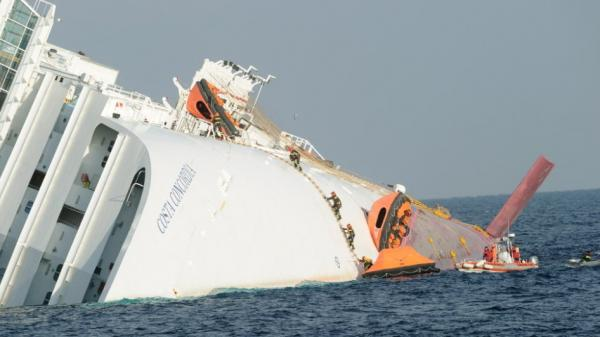 Searchers climbing on to the Costa Concordia earlier today (Jan. 19, 2012).