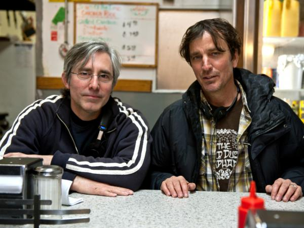 Director/screenwriter Paul Weitz (left) adapted Nick Flynn's 2004 memoir, <em>Another Bulls- - - Night in Suck City</em>.
