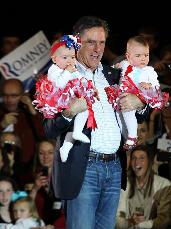 Mitt Romney holds babies during a campaign rally Sunday in Knoxville, Tenn. On Tuesday, Romney finished a distant second to Rick Santorum in the state.