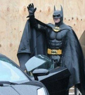 The Caped Crusader, about to get into his Batmobile.