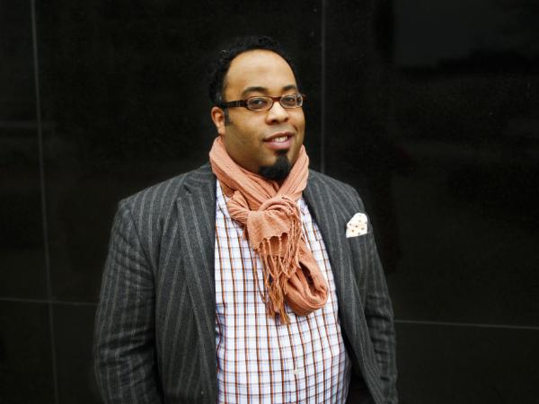 Poet Kevin Young visits NPR headquarters in Washington, D.C., on Friday as a NewsPoet guest.