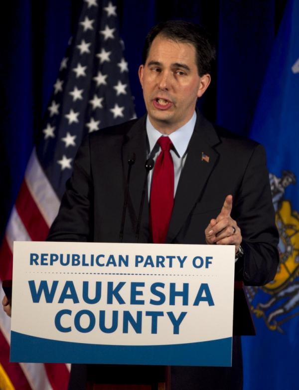 Wisconsin Gov. Scott Walker speaks to the Waukesha County Republican dinner in Pewaukee, Wis., on Saturday.