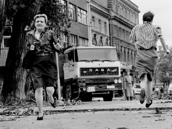 "In this photo from 1992, women run across ""Sniper Alley"" under the sights of Serb gunmen during the siege of Sarajevo."