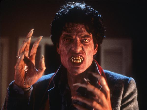 Traditional monster makeup helped transform actor Chris Sarandon in the 1985 version of <em>Fright Night.</em>