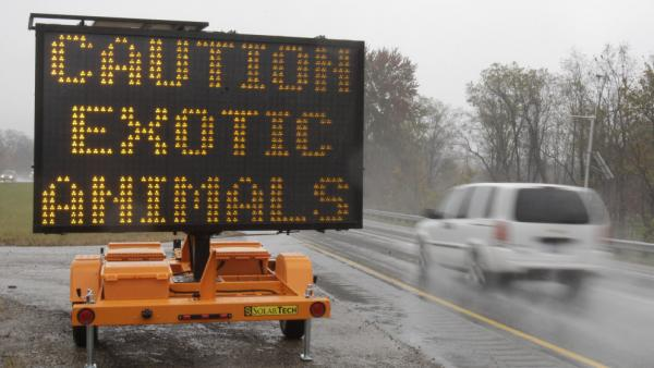 A sign warning motorists that exotic animals were on the loose near Zanesville, Ohio, last October.