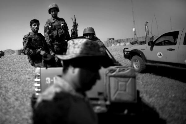 Afghan soldiers on Marjah's outskirts. U.S. Marines will depart in the coming weeks, leaving a skeleton crew to work with Afghan forces.