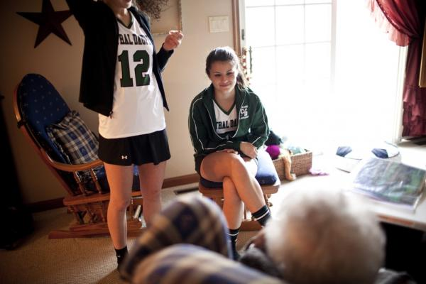 "Carley, 17, chats with AnnaBelle, whom the family affectionately calls ""Snootzie,"" after returning from lacrosse practice."