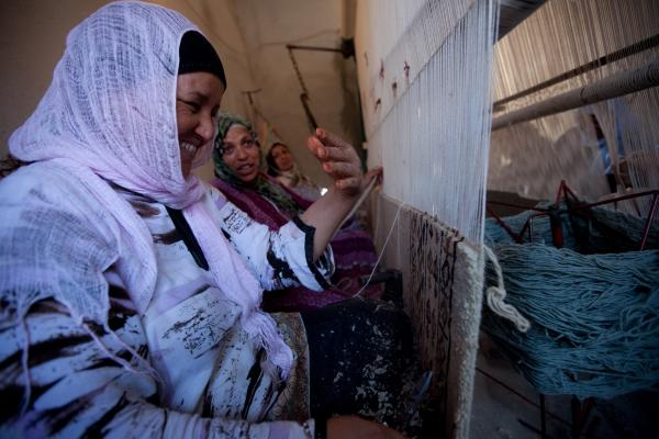 <p>Workers at a carpet-making business in the town of Kairouan are paid about $2.50 a day. Many carpet buyers are tourists, but the number of foreign visitors has dropped since the revolution.</p><p></p>