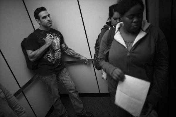 Jay Blake (left), who served in the Marines, rides the elevator with his fellow students at Sierra Community College in Rocklin, Calif.