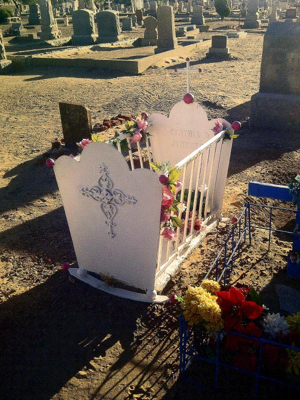 An infant grave for Cynthia Jimenez. The children's section of the cemetery is said to be haunted.