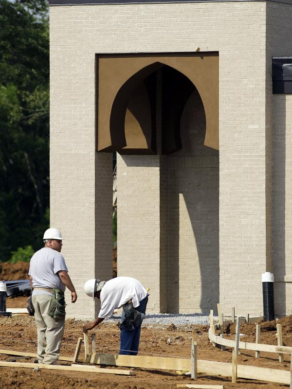 Construction employees work on the Islamic Center of Murfreesboro in Tennessee.