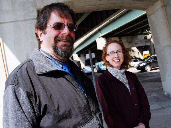 Bill Egloff, I-81 project manager for the New York State Department of Transportation, and Meghan Vitale of the Syracuse Metropolitan Transportation Council stand underneath the I-81 viaduct in Syracuse, N.Y.