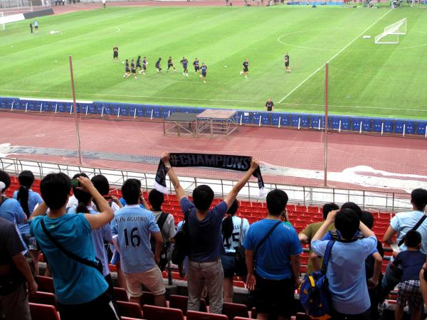 Hardcore fans were allowed to watch a Manchester City training session ahead of a match against rival Arsenal in Beijing's Bird's Nest stadium Friday.