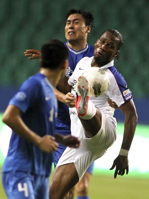 Speculation is rampant over the salary of Shanghai Shenhua's Didier Drogba, formerly with Chelsea, shown here during his Chinese Super League debut against Guangzhou Fuli in Guangzhou in southern China, July 22.