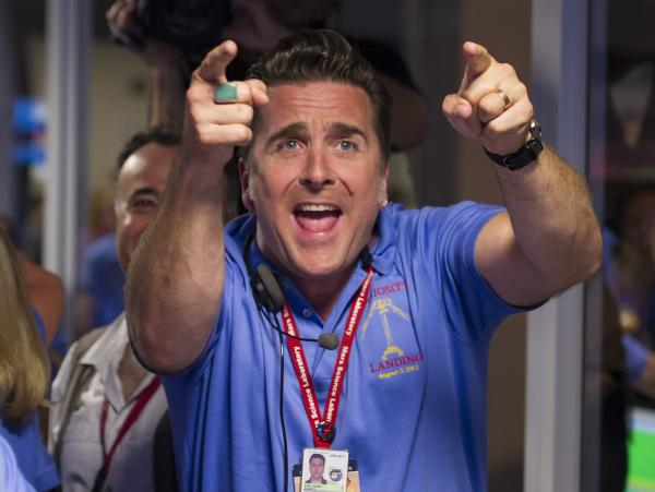 Adam Steltzner, the leader of the rover's entry, descent and landing engineering team, cheers after Curiosity touched down safely on Mars on Sunday.