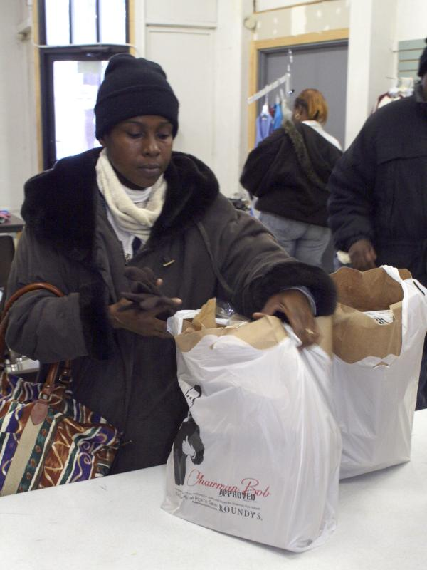Jacque Holland, 43, of Milwaukee picks up food at the food pantry at United Methodist Children's Services of Wisconsin.