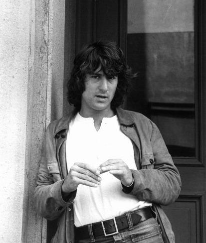 Robert De Niro leaning against a wall in a scene from Martin Scorsese's <em>Mean Streets</em>.