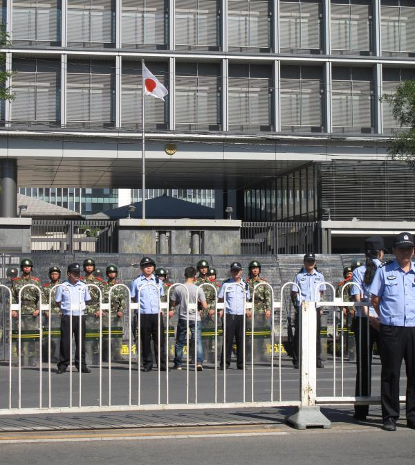 The Japanese flag flies in front of the embassy, whose walls were yolk-stained after being pelted with eggs during weekend protests.