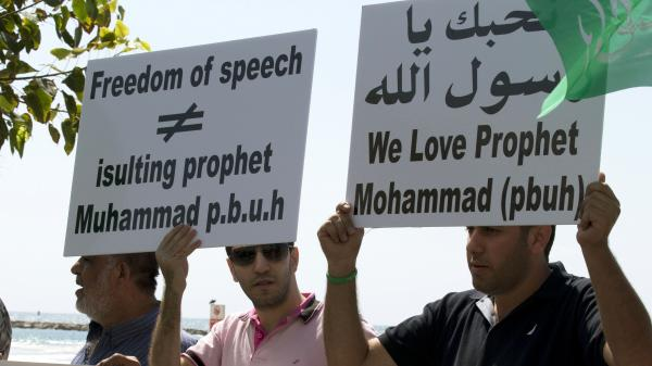 Arab-Israeli men protest a video mocking the Prophet Muhammad, in front of the U.S. Embassy in Tel Aviv, Israel, on Thursday.